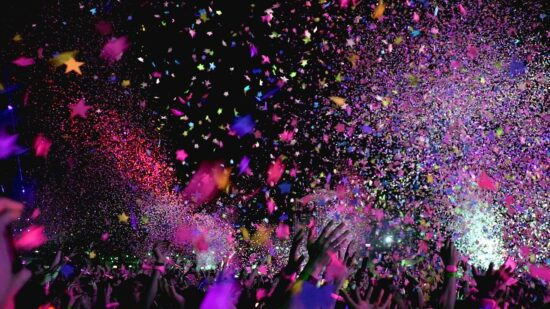 New years eve party concert with colorful confetti blowing in the air