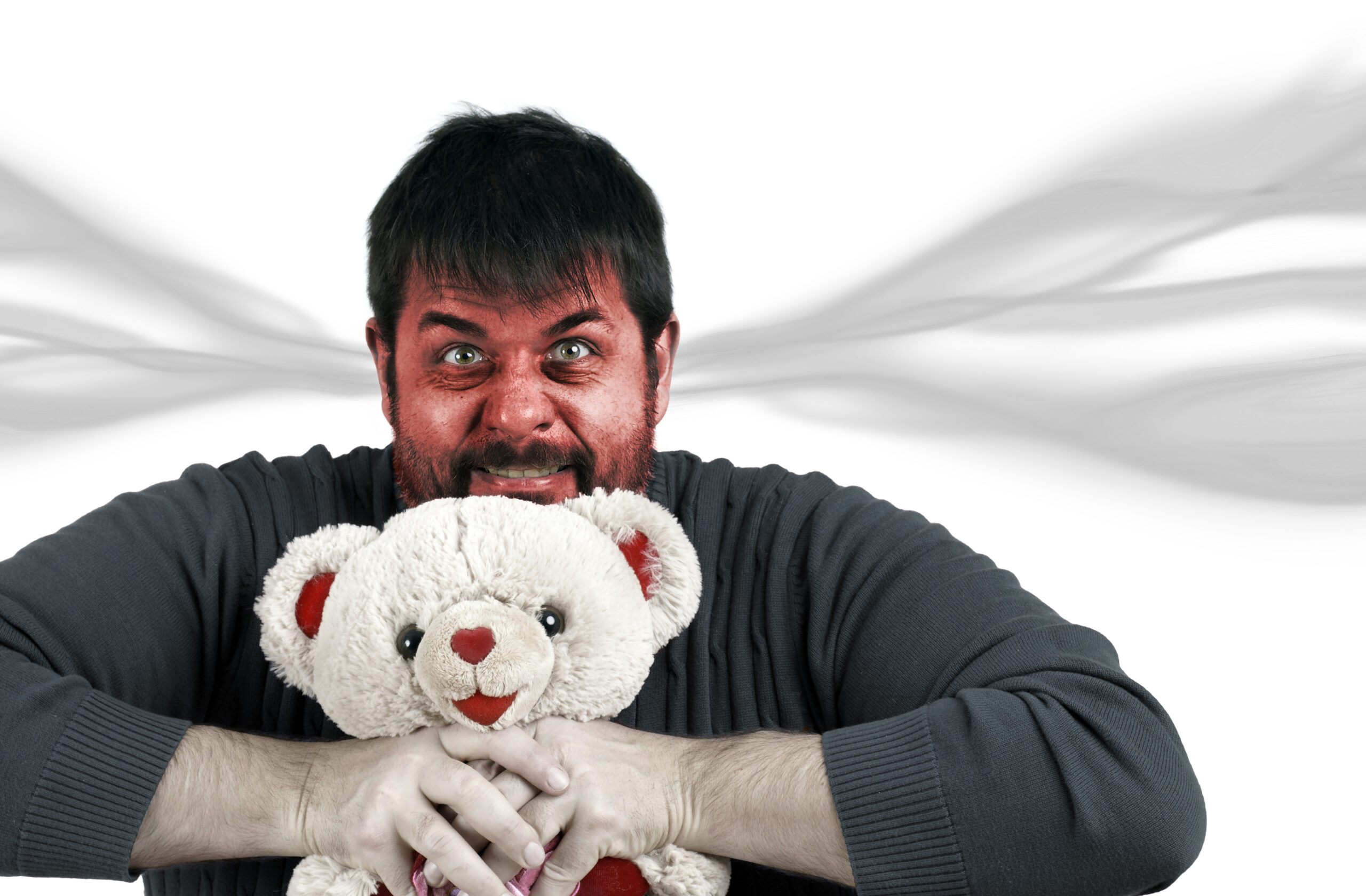 angry man with a teddy bear