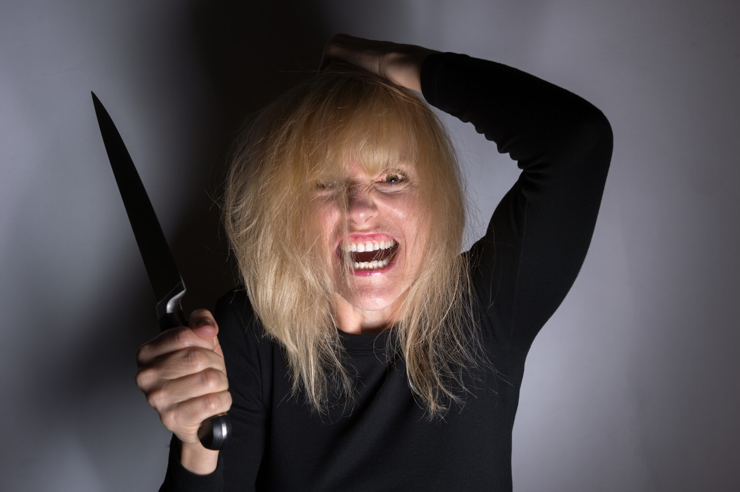 psycho woman holding a knife